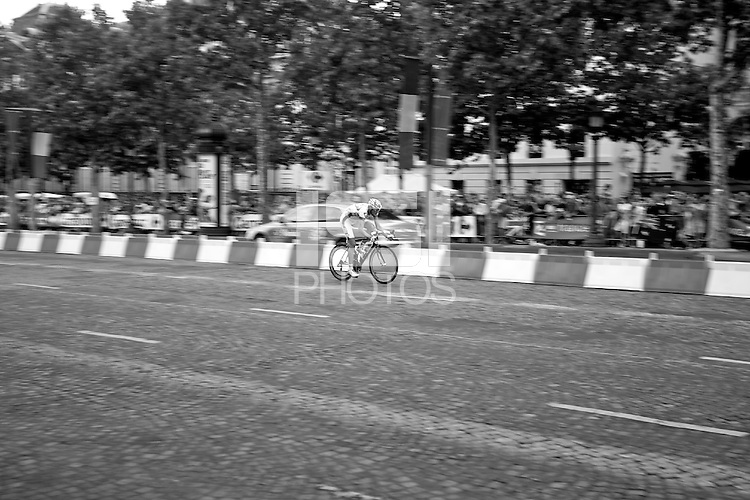 Francaise des Jeux professional cyclist Anthony Roux rides alone on the Champs Elysees in Paris on 25th July 2010