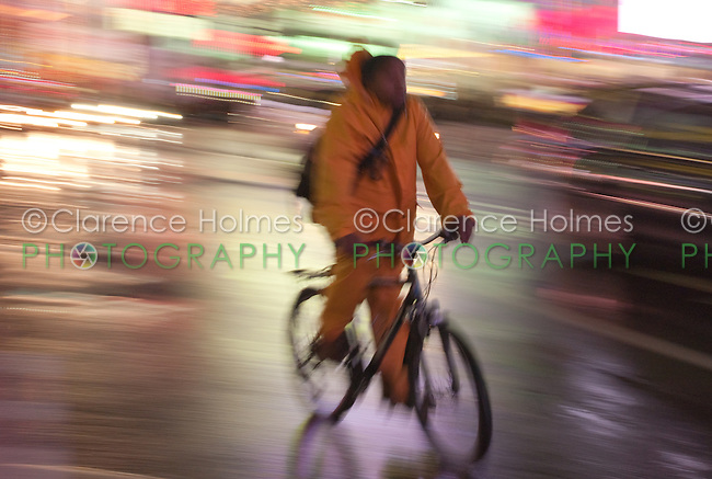 Motion blurred abstraction of cyclist riding through Times Square