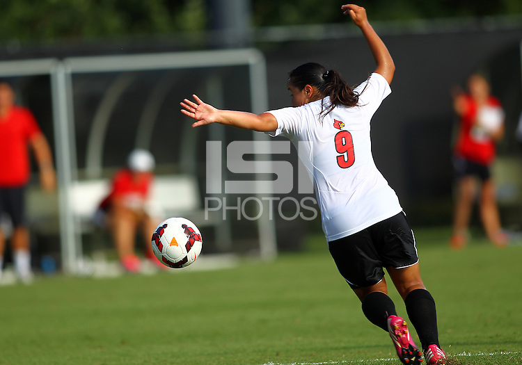 WINSTON-SALEM, NORTH CAROLINA - August 30, 2013:<br /> Charlyn Corral (9) of Louisville University picks up a pass against Virginia Tech during a match at the Wake Forest Invitational tournament at Wake Forest University on August 30. The game ended in a 1-1 tie.