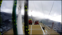 BNPS.co.uk (01202 558833)<br /> Pic: ClipperRace/BNPS <br /> <br /> ***Please Use Full Byline***<br /> <br /> Both Liz Richards (65) and Sarah Usher (34) got safely back onboard the Great Britain. The storm has passed. <br /> <br /> This is the heart-stopping moment two British sailors are washed off the side of a yacht as it is knocked flat by a tornado in the middle of the ocean.<br /> Sarah Usher and Liz Richards are seen desperately trying to grab hold of the 70ft boat as they are swept overboard when the freak weather conditions hit.<br /> Their 70ft yacht was blown onto one side as the wind built then smashed almost 180 degrees onto the other as the tornado struck.<br /> Winds of more than 115mph pinned the capsized yacht down for around 60 seconds.<br /> Dramatic footage of the ordeal shows the boat's crew dragging the pair out of the water and back on board the boat as the winds ease.<br /> The tornado can then be seen disappearing into the distance as the boat returns to upright.<br /> Sarah, 34, from Hull, East Yorks, and Liz, 65, from Dartmouth, Devon, were both wearing life jackets at the time and were shaken but uninjured in the ordeal.<br /> They were part of an 18-strong crew on the Great Britain yacht competing in the Clipper Round the World Race, a 40,000-mile yacht race for amateur sailors.