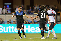SAN JOSE, CA - AUGUST 24: Andres Rios #25 celebrates withCarlos Fierro #21 of the San Jose Earthquakes during a Major League Soccer (MLS) match between the San Jose Earthquakes and the Vancouver Whitecaps FC  on August 24, 2019 at Avaya Stadium in San Jose, California.