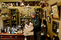 Vender Paul Body with Counter Exchange works to restock his inventory inside his booth at the Depot at Gibson Mill, an antique and designer mall that was once a mill, located in Concord, N.C. With 85,000 square feet and 460 booths, the antique mall is one of the largest antique and designer mall in the South..Once a part of the old Cannon Mills, the charm of the 20 foot ceilings, wide wooden floors and exposed brick remains. Photo is part of a photographic series of images featuring Concord, NC, by Charlotte-based photographer Patrick Schneider..
