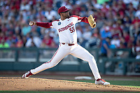 Arkansas Razorbacks pitcher Isaiah Campbell (55) delivers a pitch to the plate during Game 2 of the NCAA College World Series against the Florida State Seminoles on June 15, 2019 at TD Ameritrade Park in Omaha, Nebraska. Florida State defeated Arkansas 1-0. (Andrew Woolley/Four Seam Images)
