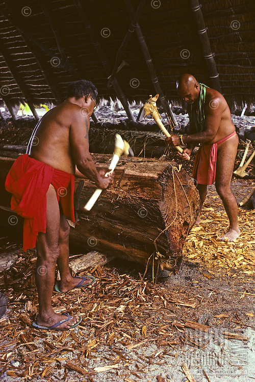 "Carving traditional Hawaiian fishing canoe, ""Mauloa,"" Puuhonua O Honaunau, Hawaii.Mau Piailug (left).Tava Taupu (right)"