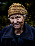 Avdiivka, eastern Ukraine, Nov. 2017.<br /> <br /> Albina Mykhailovna, 78, in front of her house. <br /> <br /> It is situated in a frontline area and has been badly damaged by rocket and artillery attacks from pro-Russian separatists. <br /> <br /> The roof now leaks constantly, the windows have been smashed and the walls cracked, but she refuses to leave.<br /> <br /> She hears the 'whistles of the bullets' when out in her garden, and once weighed 90 kilos but has lost a lot of weight due to stress.<br /> <br /> Only 5-8 families remain living in her street and almost all the houses have been damaged from shelling.<br /> <br /> She has lived in this street, on the outskirts of Avdiivka all her life.