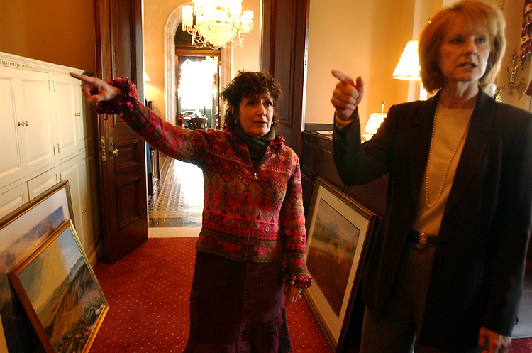 At left, Landra Reid, wife of new Senate Minority Leader Harry Reid, D-N.M., and Andrienne Powers of the Architect of the Capitol, direct the move into his new Capitol office.