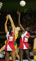 16.11.2007 England's Geva Mentor and Sonia Mkoloma and Australian Sharelle McMahon in action during the Australia v England match at the New World Netball World Champs held at Trusts Stadium Auckland New Zealand. Mandatory Photo Credit ©Michael Bradley.