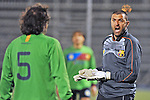 A goalkeeper argues with a team mate during a soccer match of amateur players.