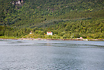 Isolated coastal houses on wooded land near Ornes, Nordland, Norway