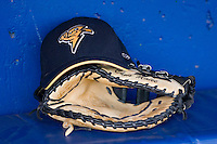 A Trenton Thunder hat sits atop the first baseman's mitt of Chris Malec (17) at Dodd Stadium in Norwich, CT, Tuesday, June 3, 2008.
