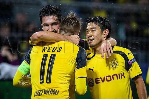 22.11.2016. Dortmund, Germany. UEFA Champions League football, Borussia Dortmund versus Legia Warsaw in Signal Iduna Park, Dortmund.  Nuri Sahin (Dortmund) celebrates his goal making it 3:1 to Dortmund with Marco Reus (Borussia Dortmund 11) and Shinji Kagawa