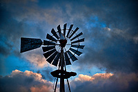 Windmill at Inniswood Metro Park against late afternoon stormy sky.