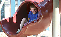 NWA Democrat-Gazette/DAVID GOTTSCHALK  Luke Lawson, 5, crawls Monday, October 9, 2017, back up in the end of one of the slides on the playground equipment at Gulley Park. Lawson was enjoying the playground with his brother before taking a break for lunch.