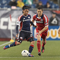 New England Revolution midfielder Lee Nguyen (24) passes the ball as Chicago Fire defender Dan Gargan (3) defends. In a Major League Soccer (MLS) match, the New England Revolution defeated Chicago Fire, 2-0, at Gillette Stadium on June 2, 2012.