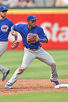 Chicago Cubs shortstop Addison Russell (27) makes the turn on a double play during a game against the Atlanta Braves at Turner Field on June 11, 2016 in Atlanta, Georgia. The Cubs defeated the Braves 8-2. (Tony Farlow/Four Seam Images)