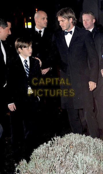 BROOKLYN BECKHAM & DAVID BECKHAM.A Night Of Heroes: The Sun Military Awards, Imperial War Museum, Lambeth Road, London, England,.15th December 2010.the millies full length black suit tie father son dad family child kid tuxedo tux bow tie profile 3/4.CAP/WIZ.© Wizard/Capital Pictures.