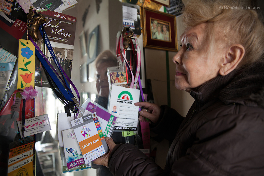 "September 29, 2015 - Mexico City, Mexico - Samantha keeps all the accreditations of the Human Rights' conferences she participated to, at her home in Mexico City. Samantha Flores is an 83-year-old transgender woman from Veracruz, Mexico. She is a prominent social activist for LGBTQI rights and is the founder of the non-profit organization ""Laetus Vitae"", a day shelter for elderly gay people in Mexico City. Senior citizens in general are many times prone to neglect and abandonment by their families, leaving them all but invisible. Their plight can be even worse if they are homosexual. Photo credit: Bénédicte Desrus"