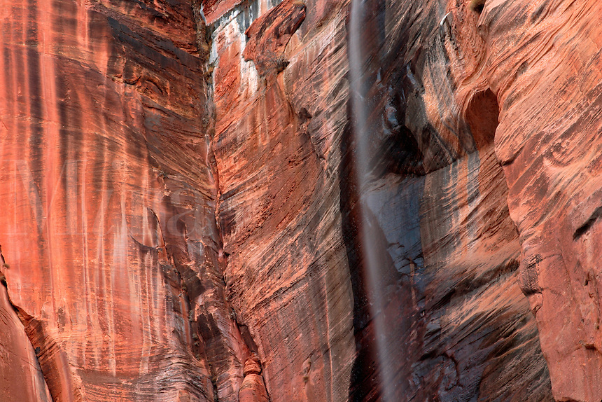 Waterfall running down red stone canyon wall, Zion National Park, Washington County, U