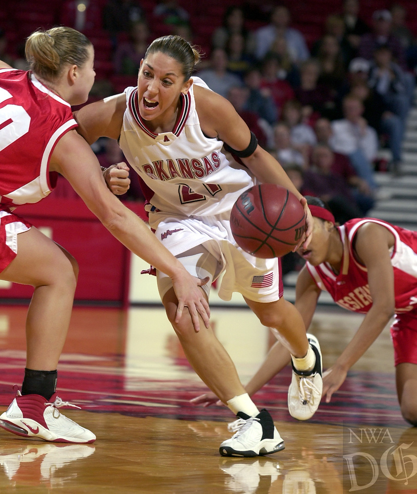 Arkansas Democrat-Gazette/AARON SKINNER<br /><br />Arkansas guard India Lewis (21) looks for a way around Western Kentucky guard Leslie Logsdon (10) in action at Bud Walton Arena Saturday afternoon.<br /><br />12-28-02