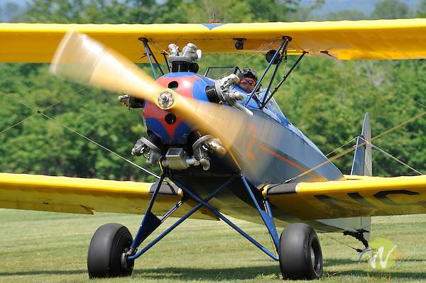 George Jenkins Fly-In. Merritt Field. 5 cylinder vintage bi-plane landing.