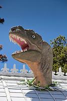 Dinosaur head bursting through roof of Plantosaurus exhibit at San Francisco Conservatory of Flowers
