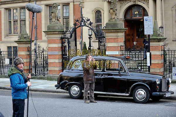 """*Exclusive*.MARCO RIMA.Seen filming """"Die Liebling"""", a swiss feature film, Lincoln Inn, London, England, UK, December 16th 2009..full length filmset film set brown leather jacket black cab taxi coat sound boom microphone man crew .CAP/IA.©Ian Allis/Capital Pictures."""