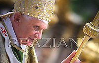 Pope Benedict XVI leaves after celebrating a mass at the end of a synod of Catholic bishops on October 26, 2008
