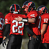 Plainedge No. 22 David Jimenez, left, and No. 75 Mike Gambardella celebrate after their team's 38-0 win over Lawrence in a Nassau County Conference III varsity football game at Plainedge High School on Saturday, October 17, 2015.<br /> <br /> James Escher