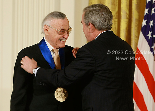 Washington, DC - November 17, 2008 -- United States President George W. Bush congratulates Stan Lee, founder of POW! Entertainment after presenting him with the 2008 National Medals of Arts award during an event in the East Room at the White House on Monday, November 17, 2008 in Washington, DC. During the event president Bush presented recipients with awards for the National Medals of Arts and the National Humanities Medal.  Credit: Mark Wilson - Pool via CNP