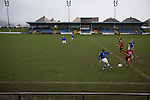 Early first-half action as Port Talbot Town (in blue) play host to Caerau Ely in a Welsh Cup fourth round tie at the Genquip Stadium, formerly known as Victoria Road. Formed by exiled Scots in 1901 as Port Talbot Athletic, they competed in local and regional football before being promoted to the League of Wales  in 2000 and changing their name to the current version a year later. Town won this tie 3-0 against their opponents from the Welsh League, one level below the welsh Premier League where Port Talbot competed, watched by a crowd of 113.