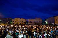 La popolazione di Lampedusa riunita nella chiesa dell'isola per partecipare alla fiaccolata per commemorare le vittime del naufragio. People attend the torchlight procession in memory of victims of the immigrant boat disaster in Lampedusa, Italy.