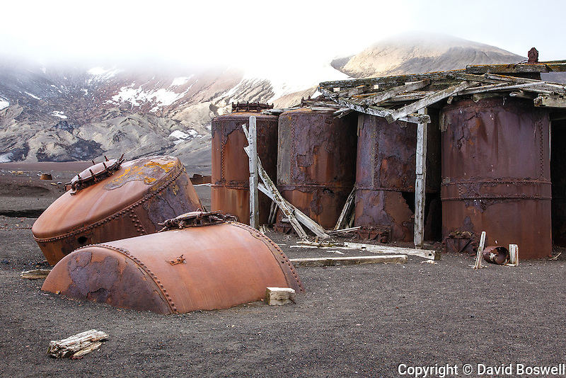 Rusted tanks are remnants from the Norwegian whaling base on Deception Island that operated from 1906-1931.  Deception Island is part of the South Shetland Islands near the Antarctic Peninsula.