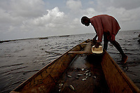 Christopher, 12 years old, works on a fishing boat in a lagoon in the Volta region, Ghana, on Saturday March 09 2007..