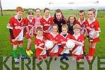 Enjoying the Cul Camp in Castlegregory on Thursday in the local GAA field from front l-r were: Cormac McDonagh, Ella Tracey, Laoise O'Herlihy and Sean Cronin. Back l-r were: Darragh Ó'Corcora, Emma Lnch, Doireann O'Neill, Rionach Kelly, Chloe Fitzgerald, Jack O'Flynn, Orla Donellan with their coach Maggie O'Sullivan.