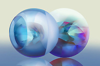 Two pastel coloured translucent spheres