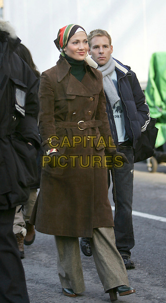 "JENNIFER LOPEZ.On the set of ""El Cantante"" filming in Central Park New York City, New York..January 4th, 2005.Photo: Jackson Lee/Admedia/Capital Pictures.Ref: JL/ADM.full length head scarf brown coat jacket black scarf gloves.www.capitalpictures.com.sales@capitalpictures.com.© Capital Pictures."