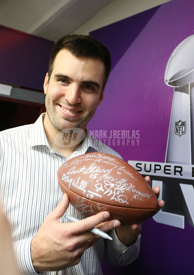 Feb 3, 2013; New Orleans, LA, USA; Baltimore Ravens quarterback Joe Flacco holds a football signed by past Super Bowl winning quarterbacks following Super Bowl XLVII against the San Francisco 49ers at the Mercedes-Benz Superdome. Mandatory Credit: Mark J. Rebilas-