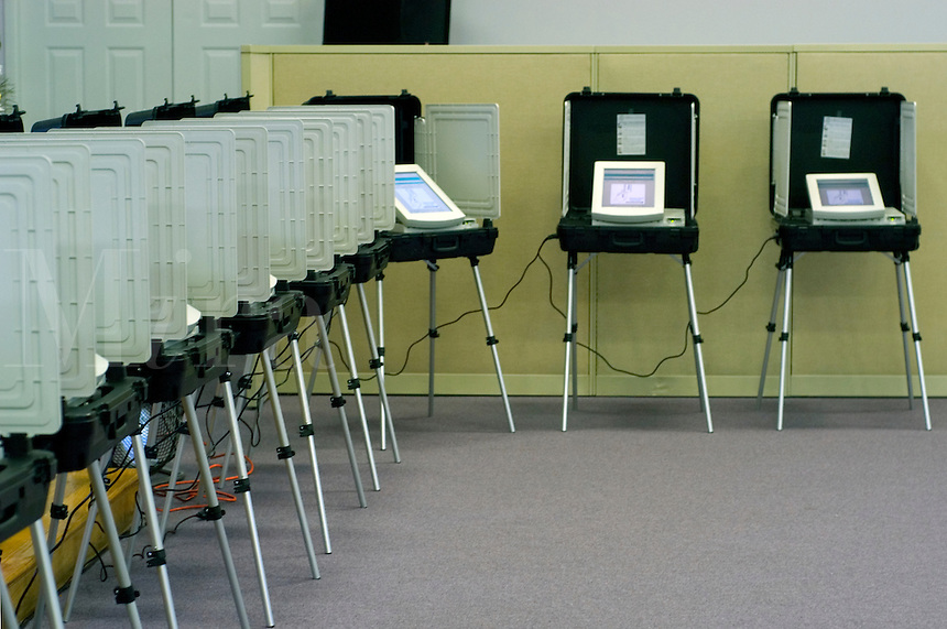 Voters use the new electronic voting booths in a DeKalb County, Georgia primary election.