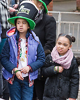 St Patricks Day parade High Street Digbeth.two wee lasses not impressed with that float it seems Camp Hill Bordesley