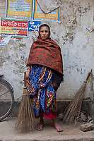 Bangladesh, Jhenaidah.  Paruti is a Dalit Hindu, or the untouchable caste working as street sweeper. There are about 5.5 million Dalit across the country, they are most neglected caste in their society.  She makes about 2000-3000 Bangladesh TK a month, or US $25. She has four children and her husband is also a sweeper. Model released.