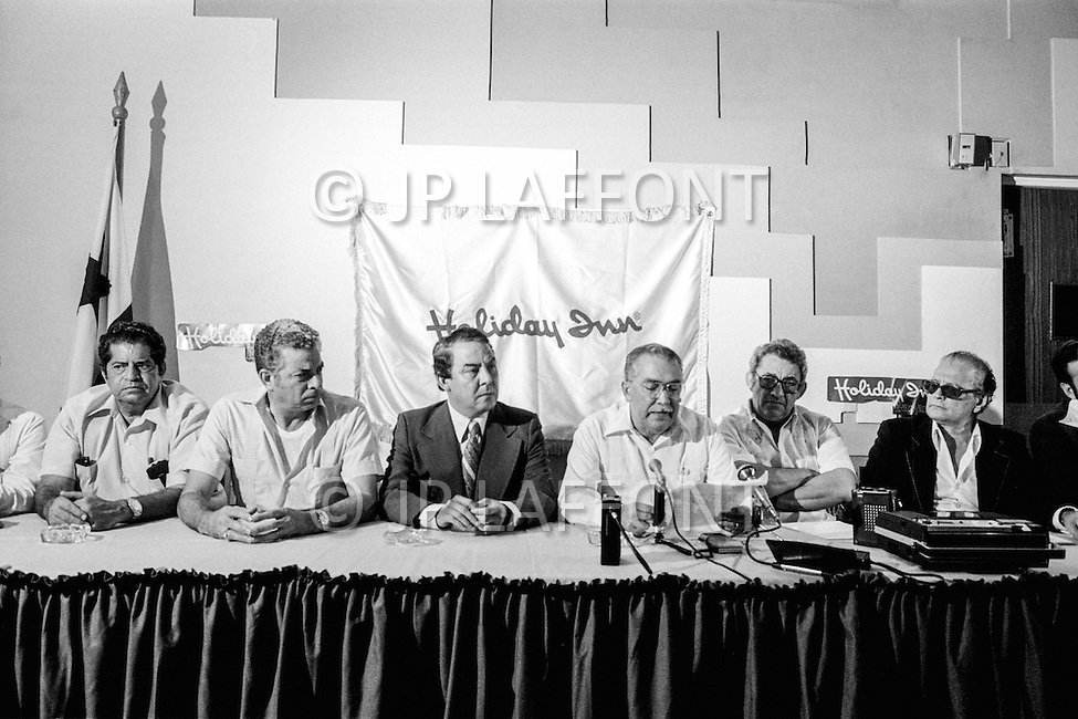 20 Apr 1978, Panama City, Panama --- The day after the decision by the American Senate to hand back the Panama Canal to the Panamanians, the representatives of different political parties held a press conference together to speak upon the subject. General Omar Torrijos, having given complete amnesty to his political adversaries, and the heads of various political affiliations rejected the offer made by the USA. (L-R) Panamanian Party Chief Jose Salvador Munoz, National Liberal Party leader Julio Harris, Independent Party leader Carlos Ivan Zuniga, and the Democrat Party representatives Samuel Levy and Carlos Arosemena. --- Image by © JP Laffont