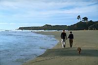 Walking the dog. Big River Beach, Mendocino, CA. Model released. CD scan from 35mm slide film.  © John Birchard