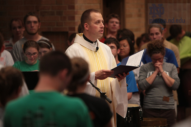 Fr. Dan Parrish celebrates mass in Keenan-Stanford Chapel