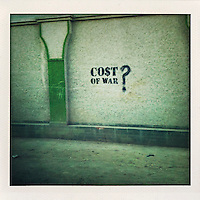Graffiti written on a Kabul wall reads 'Cost of war?'