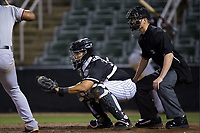 Kannapolis Intimidators catcher Wilfredo Rodriguez (37) sets a target as home plate umpire Mark Bass looks on during the game against the Hickory Crawdads at Kannapolis Intimidators Stadium on April 22, 2017 in Kannapolis, North Carolina.  The Intimidators defeated the Crawdads 10-9 in 12 innings.  (Brian Westerholt/Four Seam Images)
