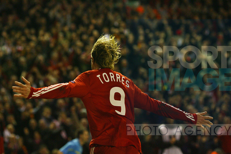 Liverpool's Fernando Torres celebrates after he scores his sides 4th goal