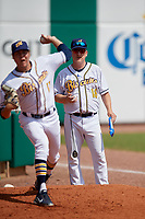 Montgomery Biscuits pitching coach R.C. Lichtenstein (18) watches starting pitcher Dalton Moats (11) warmup before a Southern League game against the Mobile BayBears on May 2, 2019 at Riverwalk Stadium in Montgomery, Alabama.  Mobile defeated Montgomery 3-1.  (Mike Janes/Four Seam Images)