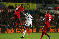 Pictured: Wilfried Bony (C).<br /> Monday 16 September 2013<br /> Re: Barclay's Premier League, Swansea City FC v Liverpool at the Liberty Stadium, south Wales.
