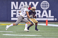 Annapolis, MD - September 8, 2018: Navy Midshipmen running back CJ Williams (20) makes a move on Memphis Tigers linebacker Austin Hall (25) after catching a pass out the backfield during game between Memphis and Navy at  Navy-Marine Corps Memorial Stadium in Annapolis, MD. (Photo by Phillip Peters/Media Images International)