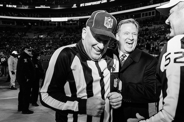 January 24, 2016. Charlotte, North Carolina.<br /> <br /> (left to right) Steve Zimmer, field judge, laughs with NFL Commissioner Roger Goodell and referee Bill Vinovich before the NFC Championship game between the Arizona Cardinals and the Carolina Panthers at Bank of America Stadium. <br /> <br /> Roger Goodell, the Commissioner of the National Football League (NFL), walks the sidelines before the NFC Championship game between the Arizona Cardinals and the Carolina Panthers at Bank of America Stadium.